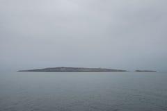 Mglista wyspa Zdjęcia Stock