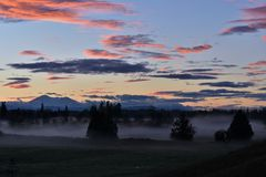 Mglisty ranku wschód słońca Obrazy Stock