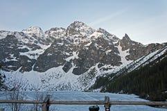 MiÄ™guszowiecki Peak and Morskie Oko Lake stock photography