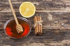 Miód, cytryna i cynamon, zdjęcie stock