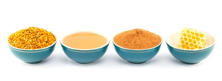 Miód, honeycomb, pollen i cynamon w pucharach, Zdjęcia Royalty Free