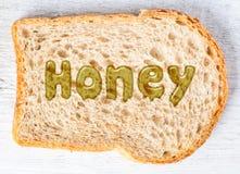 Miód na plasterku chleb zdjęcia royalty free