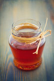 Miód w szklanym słoju Fotografia Stock