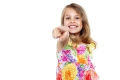 Miúdo bonito da menina que aponta em você Fotografia de Stock Royalty Free
