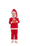 Miúdo bonito no traje de Santa com presente Fotografia de Stock