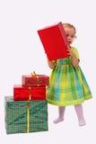 Miúdo com presentes Foto de Stock