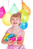 Miúdo com presentes de aniversário Foto de Stock Royalty Free