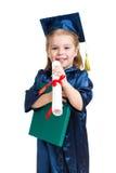 Miúdo da menina na roupa do academician com livro fotos de stock royalty free