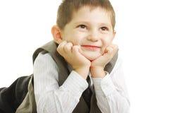 Miúdo de sorriso que olha acima Fotografia de Stock Royalty Free