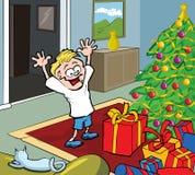 Miúdo dos desenhos animados em presentes da abertura da manhã de Natal Fotos de Stock Royalty Free