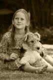 Miúdo e animal de estimação Foto de Stock Royalty Free