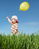 Miúdo e balão Foto de Stock