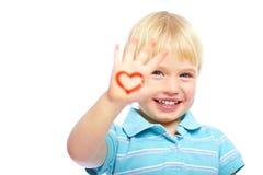 Miúdo feliz com pinturas na mão imagem de stock