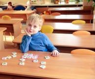 Miúdo no jardim de infância Fotos de Stock Royalty Free