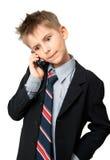 Miúdo que fala em um telefone de pilha Fotografia de Stock Royalty Free