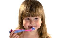 Miúdo que vai limpar os dentes Imagens de Stock Royalty Free