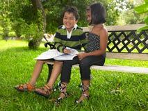 Miúdos asiáticos em um parque Imagem de Stock Royalty Free