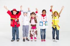 Miúdos com trabalhos Imagem de Stock Royalty Free