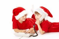 Miúdos e telefone Fotos de Stock