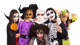 Miúdos em trajes de Halloween Fotos de Stock