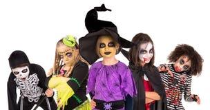 Miúdos em trajes de Halloween Fotos de Stock Royalty Free