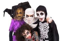 Miúdos em trajes de Halloween Fotografia de Stock Royalty Free