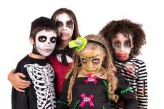 Miúdos em trajes de Halloween Fotografia de Stock