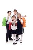 Miúdos felizes da escola primária - isolados Foto de Stock