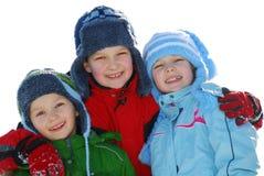 Miúdos felizes do inverno fotos de stock