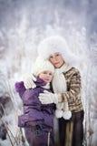 Miúdos no inverno Fotografia de Stock