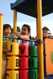 Miúdos no parque Fotografia de Stock Royalty Free