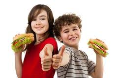 Miúdos que comem sanduíches saudáveis Fotos de Stock Royalty Free