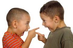 Miúdos que discutem 4 e 5 anos velho Fotografia de Stock Royalty Free