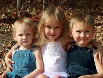 Miúdos três irmãos Imagens de Stock Royalty Free