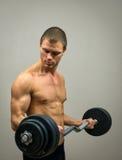 Mięśniowej samiec wzorcowi robi ćwiczenia Obraz Stock
