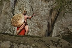 Mięśniowy antyczny wojownik na naturze Zdjęcia Stock