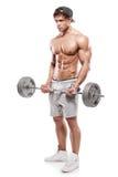 Mięśniowy bodybuilder facet robi ćwiczeniom z dużym dumbbell obraz stock