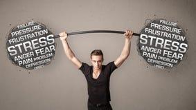 Mięśniowy mężczyzna bój z stresem zdjęcie stock