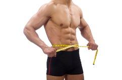 Mięśniowy mężczyzna mierzy jego mięśnie Obrazy Stock