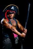 Mięśniowy mężczyzna w pirata kostiumu Obraz Stock