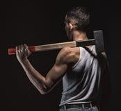 Mięśniowy mężczyzna z młotem od plecy Zdjęcia Stock