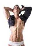 Mięśniowy młody człowiek z sleeved koszula na nagiej półpostaci obraz royalty free