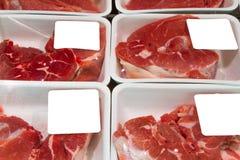 Mięso plasterki w pudełkach Obrazy Royalty Free