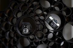 Miłość dla fotografii, twórczość Twórczość Dwa ekranowej kamery na czarnym abstrakcjonistycznym tle uczenie fotografia zdjęcie royalty free