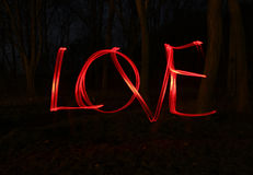 Miłość i światło - zamazuje fotografię czerwone lampy Zdjęcie Royalty Free