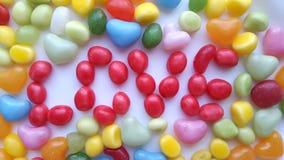 Miłość kolorowe cukierki Obrazy Stock