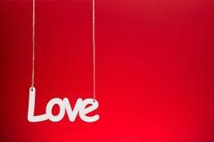 Miłość na czerwonym tle Fotografia Royalty Free