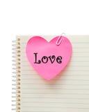 Miłość na różowym sercu Obrazy Royalty Free