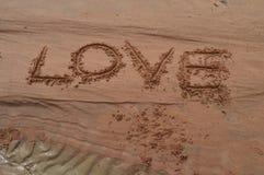 Miłość pisać na piasku Fotografia Royalty Free