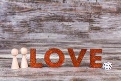 Miłość teksta gry kostka do gry i postacie Obraz Royalty Free
